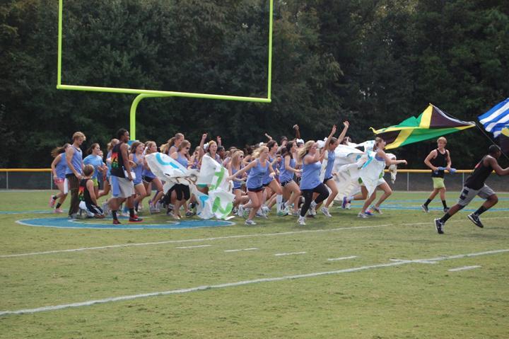 The Junior/Sophomore team breaks the banner