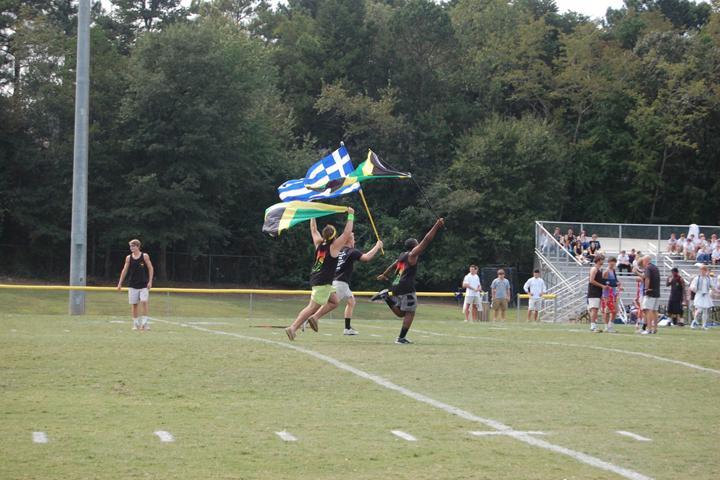 Junior and Sophomore boys run their flags across the field