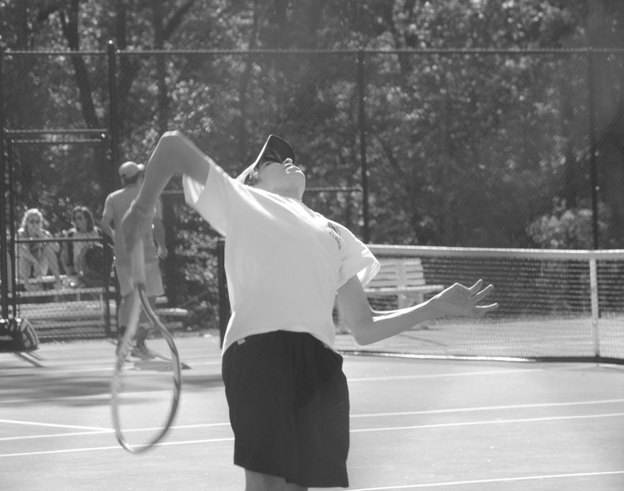 Cavalier tennis player serves up the ball