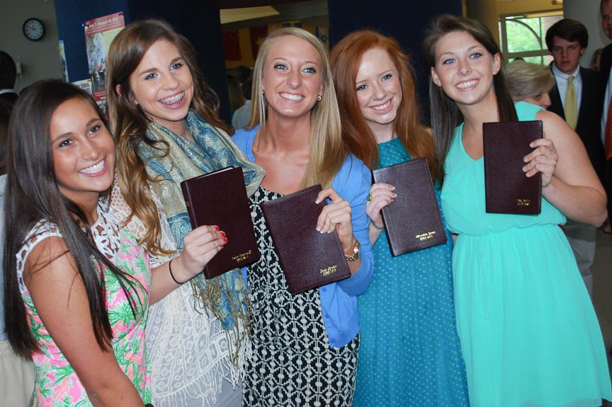 Seniors pose proudly with their Bibles