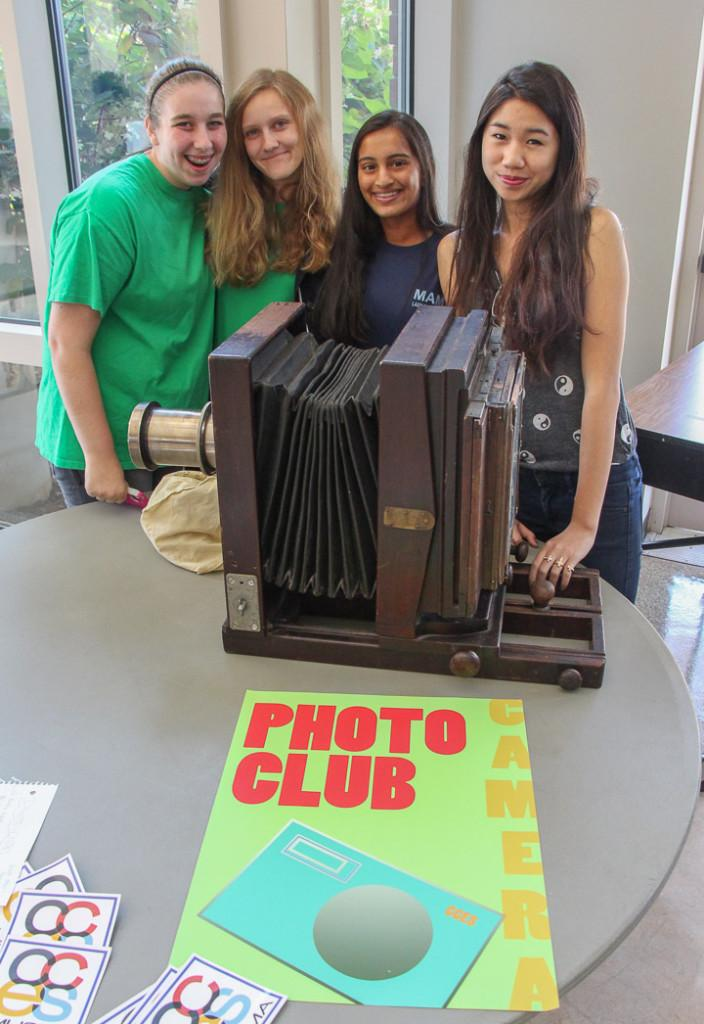 The Photo Club poses with an archaic camera