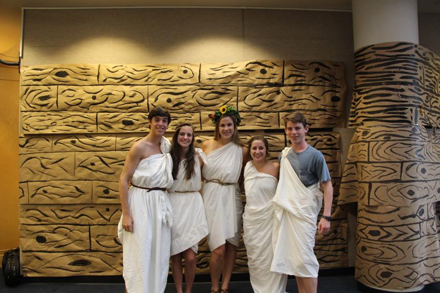 Toga-clad students pose for the camera.