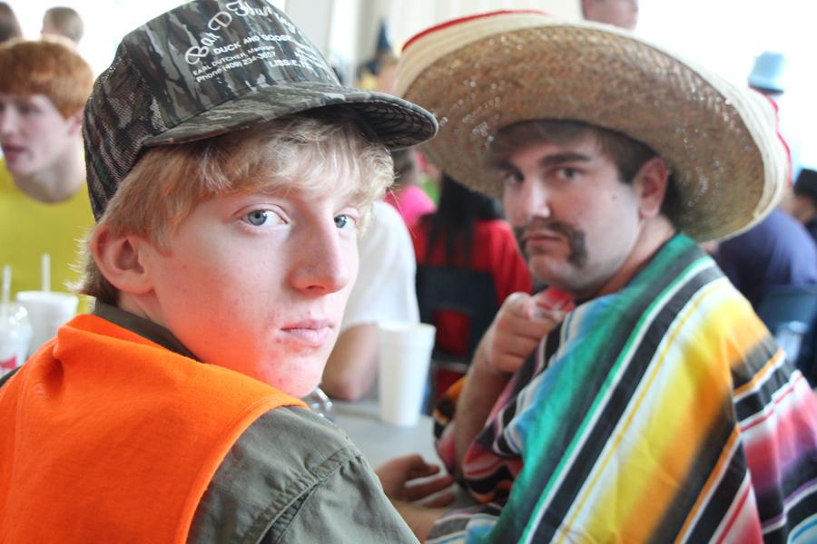 Two students reluctantly display their costumes