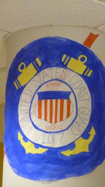 The Freshmen, as the U.S. Coast Guard, display their symbol.