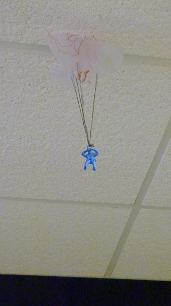 A lone soldier, one of many hung on the ceiling, is part of the Homecoming decorations.