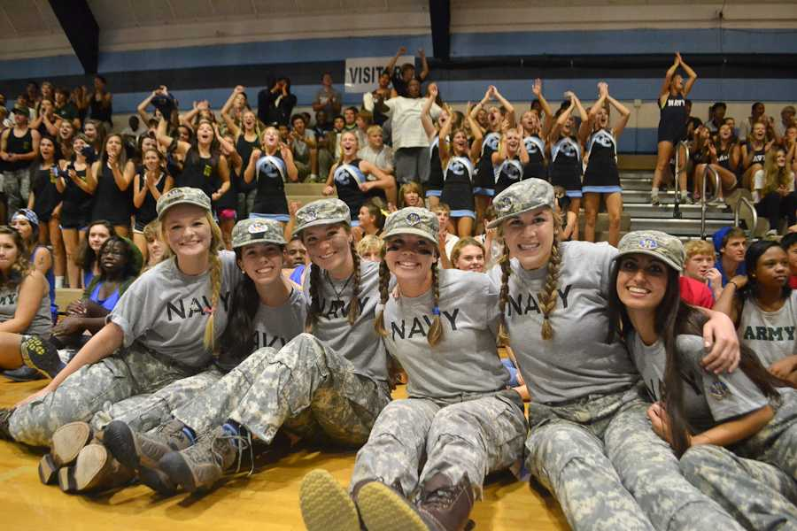 Senior girls, dressed as the Navy Seal Team 6, are all smiles at the pep rally.