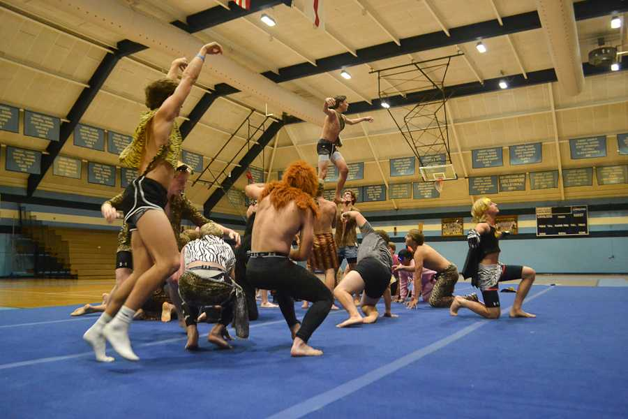 The Sophomore-Junior male dance team leaps and jumps to the music.