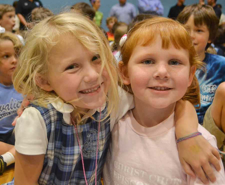 Two Lower Schoolers display their excitement for participating in the pep rally.