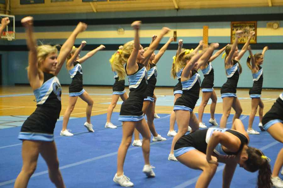 The Varsity Cheerleaders perform for the Upper School.