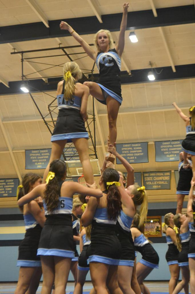 The cheerleaders show off their lifting skills.