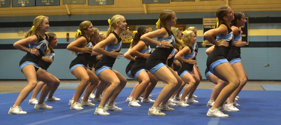 The Varsity Cheerleading team performs some new moves.