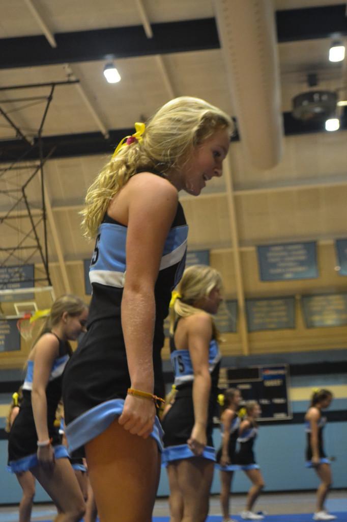 A Varsity Cheerleader prepares for the dance to begin.