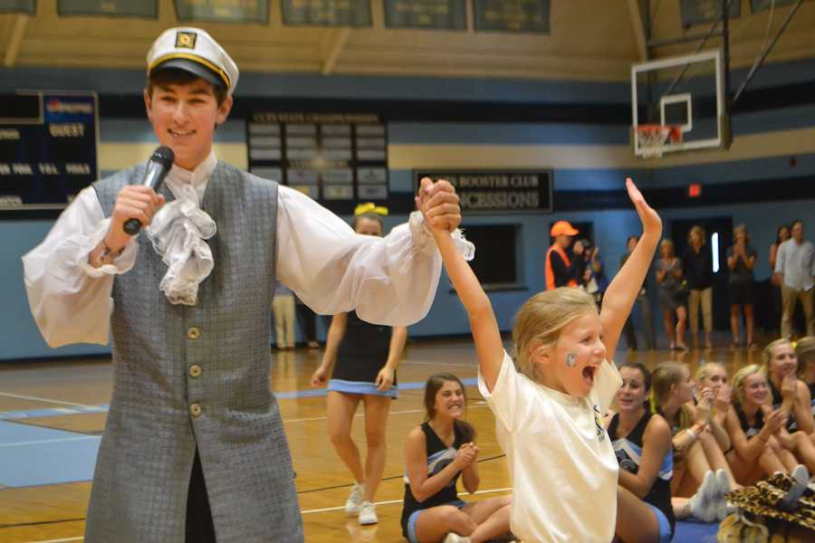 The Christ Church Cavalier, along with an enthusiastic Lower Schooler, kick off the pep rally.