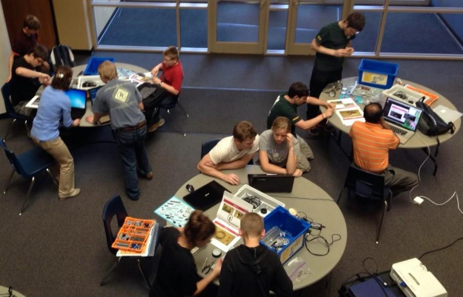 Students work together to build robots for the Robot Competition.