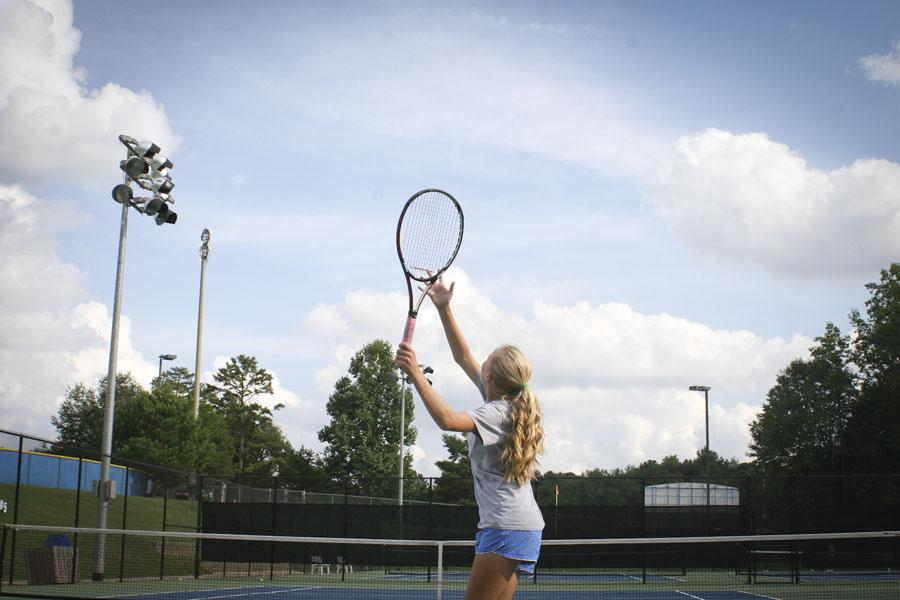 Freshman Lauren Allen warms up her serve before the match.