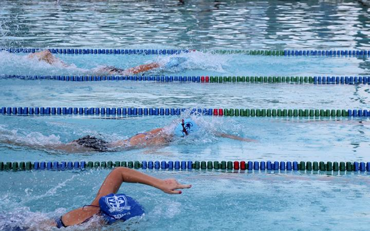 A+swimmer+competing+at+a+home+meet+earlier+in+the+season.+%28Michael+Stone%2FStaff%29