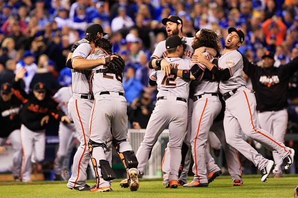 The San Francisco Giants celebrate after their game 7 win over the Royals
