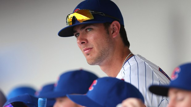 Kris+Bryant+of+the+Chicago+Cubs+watches+from+the+dugout+during+the+spring+training+game+against+the+Arizona+Diamondbacks+at+Cubs+Park+on+February+27%2C+2014+in+Mesa%2C+Arizona+%28Christian+Petersen%2FGetty+Images%29.