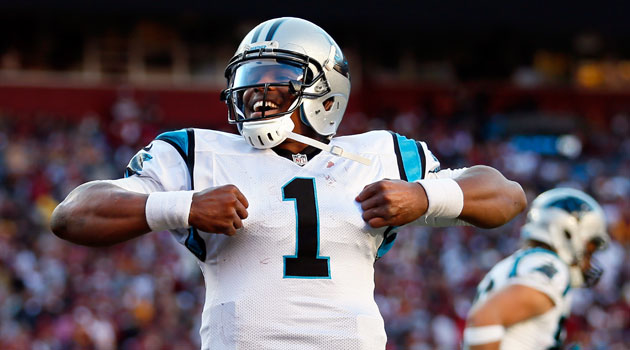 Cam Newton doing his signature touchdown celebration dance (Rob Carr/Getty Images).