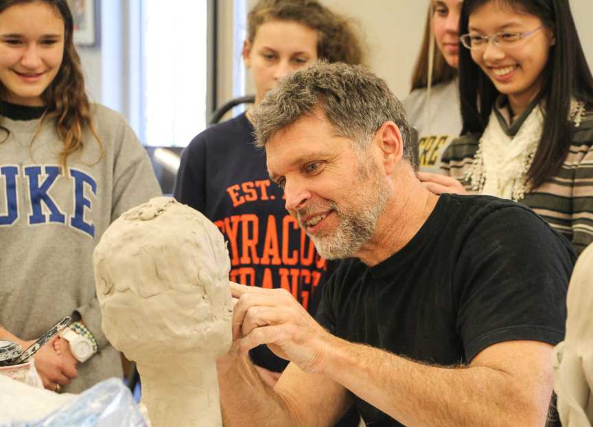 Artist in Residence Nick Ring works with Mrs. Abrams's 5th period IB Art Class (Darcy Merline / Staff Photo).