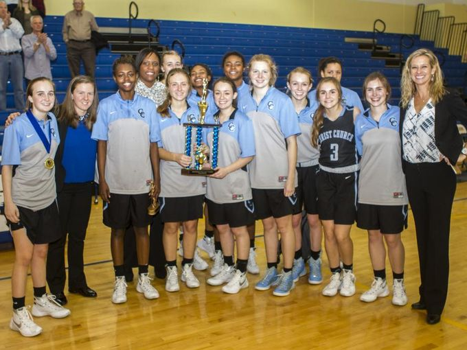 The+girls+basketball+team+celebrates+with+their+trophy+at+the+Lady+Sandlapper+Tournament+%28Darcy+Merline%2FStaff+Photo%29.