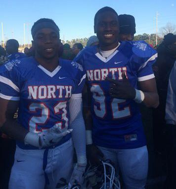 Dixon and Putman bask in the final moments of their high school football careers.